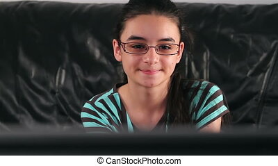 Teenage girl watching TV - Teenage girl with glasses...