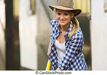 cowgirl working in stables - happy cowgirl working in...