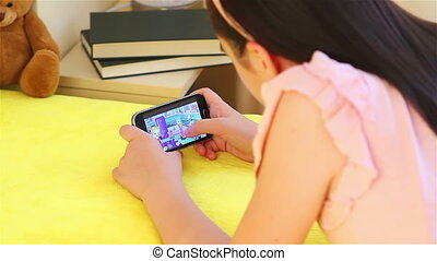 Girl playing on smartphone