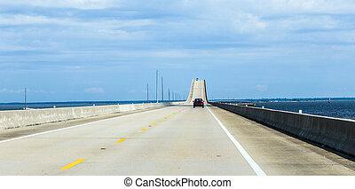 crossing the Dauphin Island Bridge in Dauphin Island, USA....