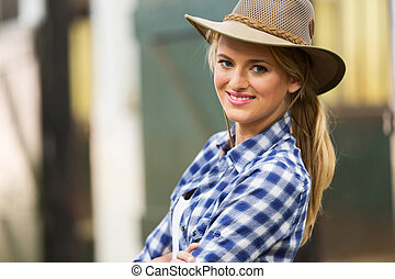 beautiful cowgirl close up portrait in stables