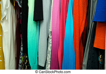close up of clothing hanging in closet