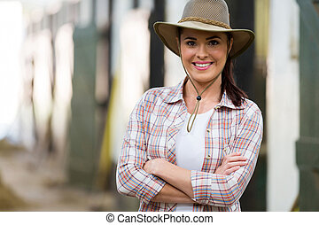 cowgirl with arms crossed - attractive cowgirl with arms...