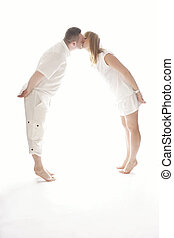 Lovely Couple Kissing While in Tiptoe