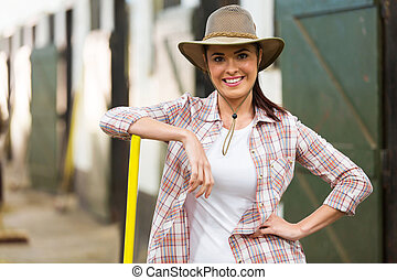 beautiful cowgirl inside stables - beautiful cowgirl working...