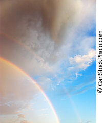 Beautiful cloudscape with rainbow - Optical phenomenon -...