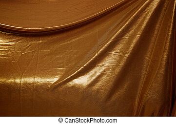 draped gold fabric background - A wrinkled gold fabric...
