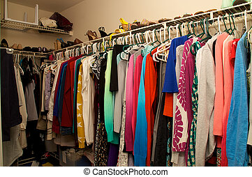 inside a woman's closet - Looking into a full walk in closet...