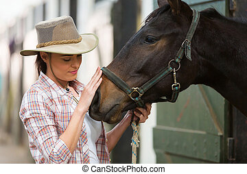 cowgirl talking to a horse - caring cowgirl talking to a...