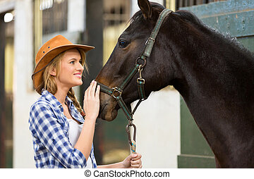 cowgirl and horse inside stable - beautiful cowgirl and...