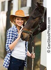 cowgirl with her horse - pretty cowgirl with her horse in...