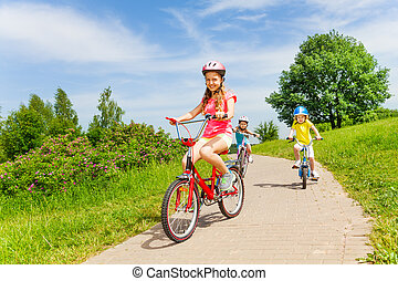 Summer bike riding - Three little girls, one teenager and...