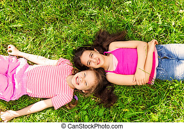 View from above of two beautiful girls on grass - View from...