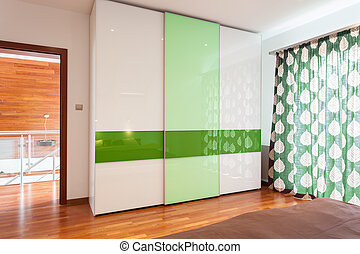 Green and white wardrobe in new house