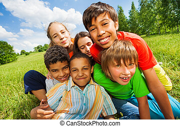 Close up view of happy smiling kids in a group together...