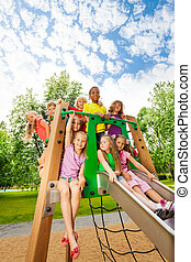 Group of friends together on a chute in summer