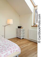 Bright bedroom in the attic
