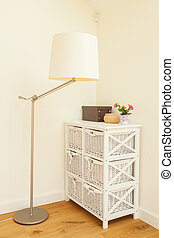 Commode and lamp in bright room - Commode and lamp in a...