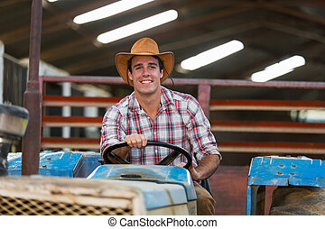 young farmer driving tractor - happy young farmer driving...