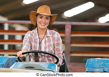 female farmer driving a tractor in farm house