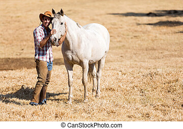 cowboy with a white horse - handsome cowboy with a white...
