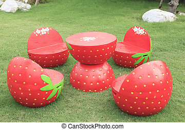 set of red strawberry garden outdoor patio desk on green grass f