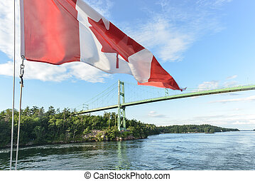 The Thousand Islands Bridge and Canadian Flag Constructed in...