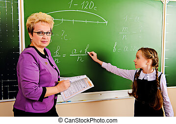 explanation - A teacher and her student during class at...