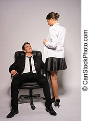 Two Young Couple in Corporate Attire Talking - Two Young...