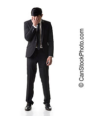 Regret young business man standing and thinking, full length...