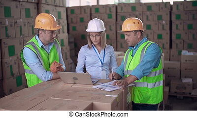 Department Meeting - Close up of three workers comparing...