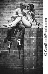 Middle Age Romantic Couple Kissing Above Wall - Fashion...