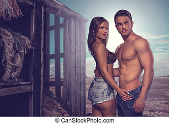 Two Sexy Couple Posing Beside Old Wooden House - Fashion...