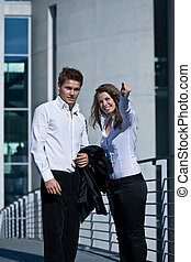 Young Corporate Man And Woman Outdoor
