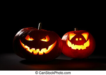 Halloween pumpkins jack-o-lantern - Two carved Halloween...