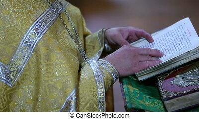 The priest says a prayer