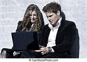 Young Corporate Couple With Laptop