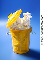 Paper trash in yellow over blue background