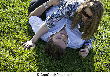 Happy Couple Playing On The Grass