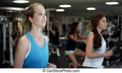 Running on a Treadmill - Woman running on a treadmill