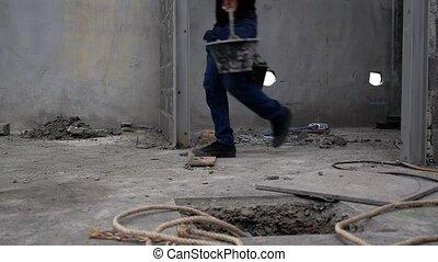 Thai Worker Throwing Construction Debris.