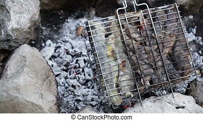 Saltwater fish on grid barbecue - Freshly caught sea fish...