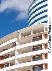 Window Washers on Modern Hotel - Modern white concrete...