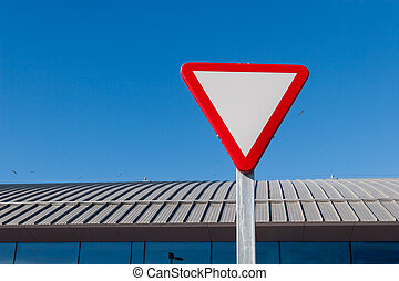 Yield sign - Yield - Give a way sign against blue sky