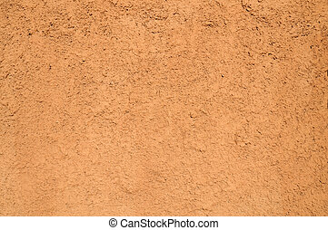 Texture of wall covered with orange plaster