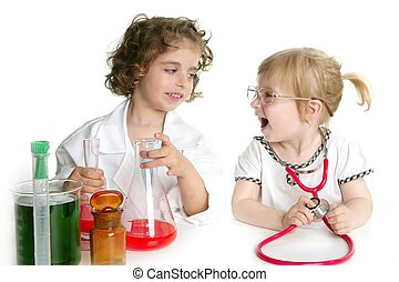 Girls pretending to be doctor in laboratory - Two girls...