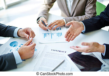 Negotiations - Image of business partners hands over...
