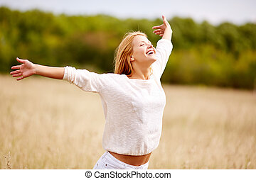 Freedom - Image of happy woman with outstretched arms...