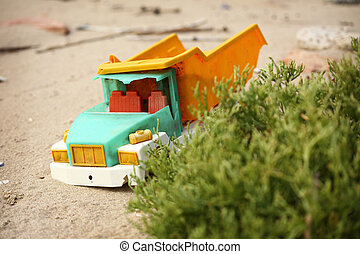 broken toy truck thrown from the sea