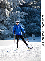 cross-country skiing - a woman runing cross-country ski....